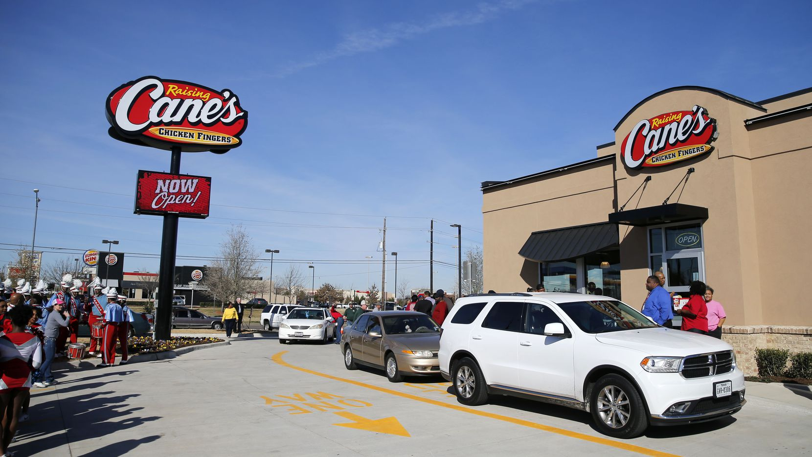 Cars line up at the grand opening of a Raising Cane's in Dallas on Feb. 16. A new study shows the number of chain restaurants on the rise in D-FW.(Vernon Bryant/The Dallas Morning News)