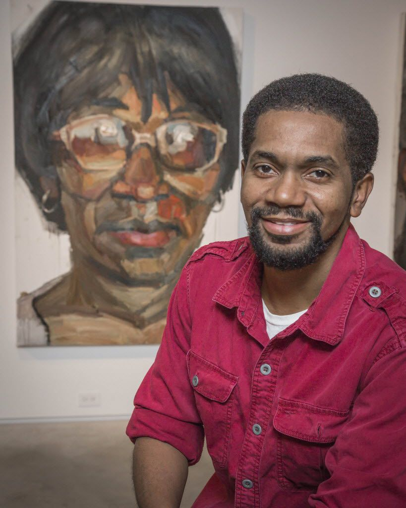 Sedrick Huckaby poses with a large painting of his mother, Ruthie Huckaby of Fort Worth, at the Valley House Gallery in Dallas, in 2013. (Ron Heflin/Special Contributor)