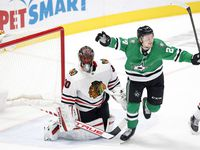 Dallas Stars left wing Roope Hintz (24) celebrates teammate Esa Lindell's (23) second period goal on Chicago Blackhawks goaltender Malcolm Subban (30) at the American Airlines Center in Dallas, Tuesday, March 9, 2021.