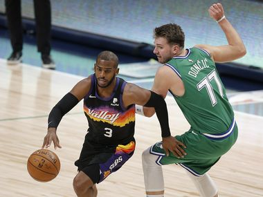 Phoenix Suns guard Chris Paul (3) gets past Dallas Mavericks guard Luka Doncic (77) during the first half of an NBA basketball game in Dallas, Saturday, January 30, 2021. (Brandon Wade/Special Contributor)