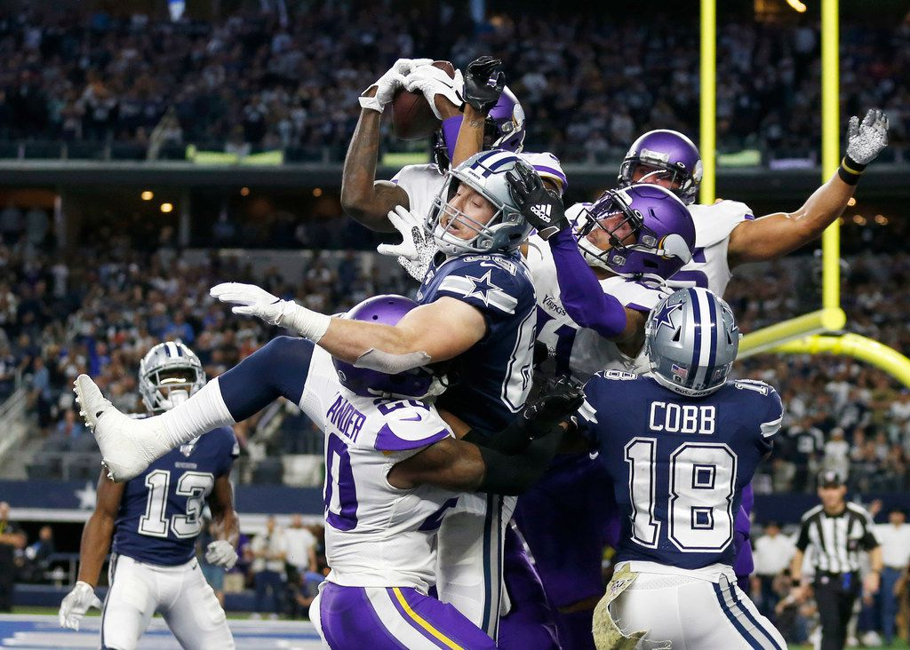 Minnesota Vikings safety Jayron Kearse (27) intercepts a last second Hail Mary pass attempt in front of Dallas Cowboys tight end Blake Jarwin (89) during the second half of play at AT&T Stadium in Arlington, Texas on Sunday, November 10, 2019. The Minnesota Vikings defeated the Dallas Cowboys 28-24. (Vernon Bryant/The Dallas Morning News)