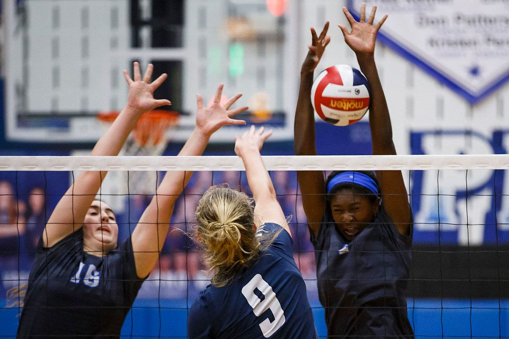 Plano West's Iman Ndiaye (right) and Lauren Blomquist (16) go up for a block against McKinney's Sophie Manson (9) during a District 6-6A volleyball match at Plano West High School on Tuesday, Oct. 17, 2017, in Plano, Texas. (Smiley N. Pool/The Dallas Morning News)
