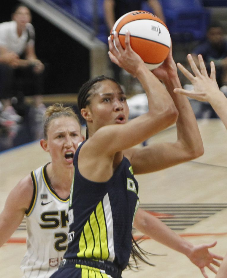 Dallas Wings forward Isabelle Harrison (20) gets off a jump shot in front of Chicago Sky guard Courtney Vandersloot (22) during second half action. The two WNBA teams played their game at College Park Center in Arlington on June 30, 2021. (Steve Hamm/ Special Contributor)