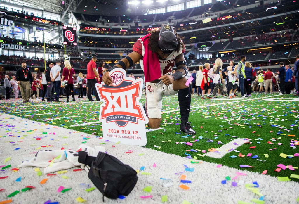Oklahoma Sooners defensive back Brendan Radley-Hiles (44) kneels on the field after winning the Big 12 Championship over the Texas Longhorns and the Oklahoma Sooners on Saturday, December 1, 2018 at AT&T Stadium in Arlington, Texas. The Sooners won 39-27. (Ashley Landis/The Dallas Morning News)