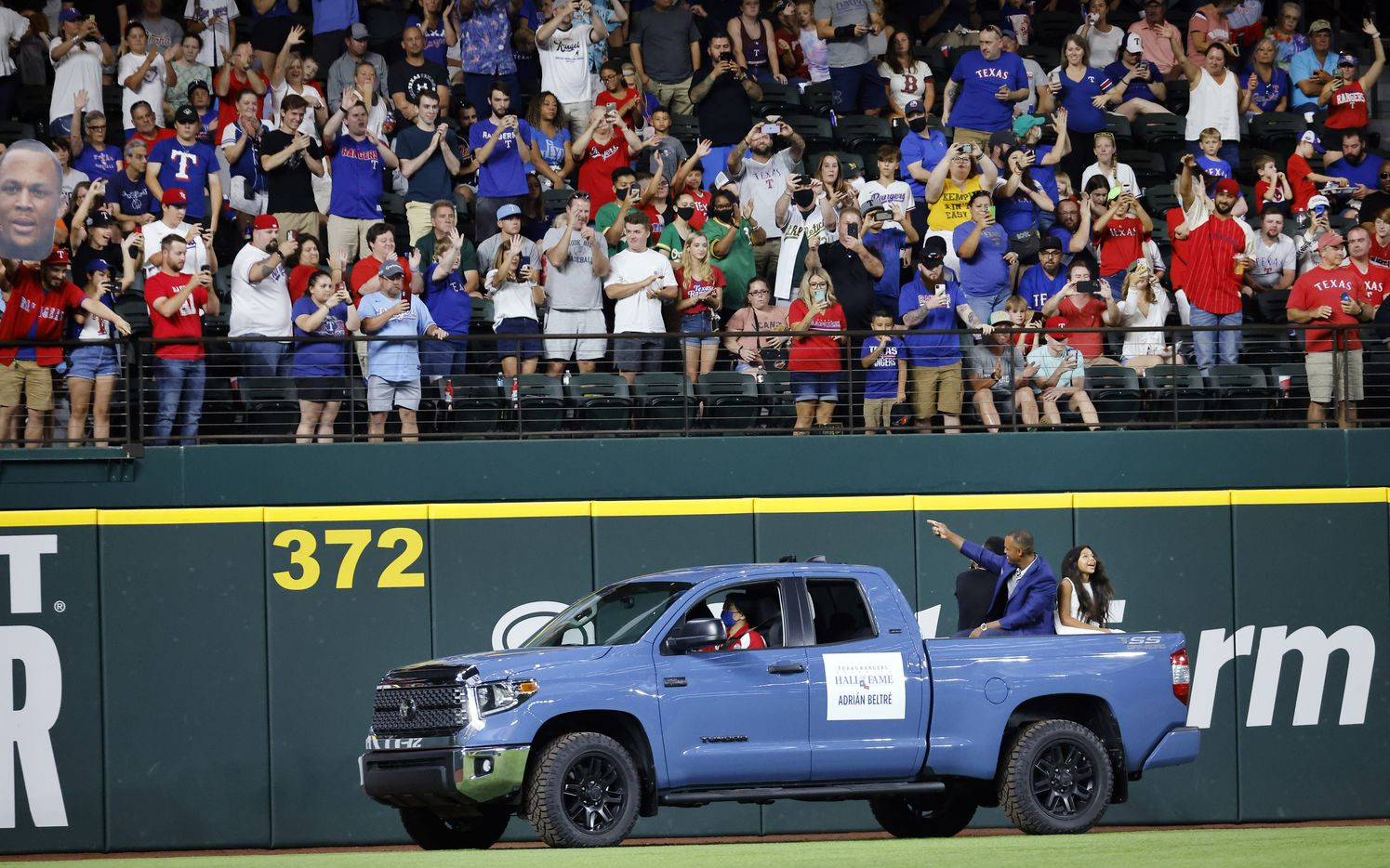 With his kids in the back of a pickup truck, former Texas Rangers third baseman Adrian Beltre waves to fans following his induction into the Texas Rangers Baseball Hall of Fame at Globe Life Field in Arlington, Saturday, August 14, 2021.(Tom Fox/The Dallas Morning News)