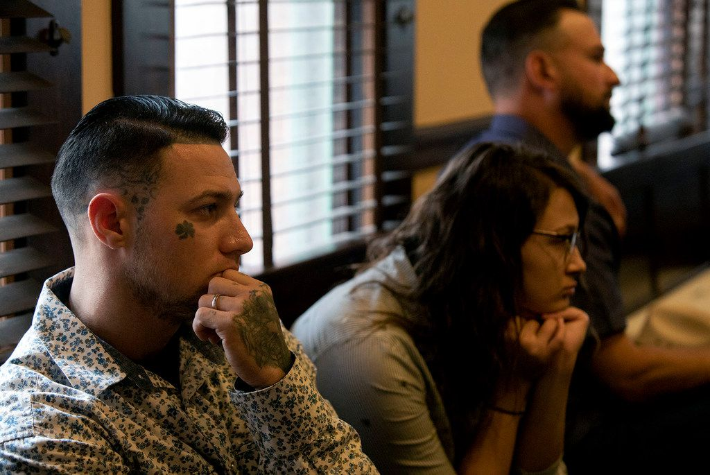 Christopher Johnson, left, whose parents, Sara and Dennis Johnson, were killed by the gunman at First Baptist Church of Sutherland Springs, watches a hearing on whether survivors and victim's families who have sued Academy Sports + Outdoors for selling Kelley the firearm he used, will go to trial, at the Bexar County Courthouse in San Antonio on Thursday, Jan. 31, 2018.