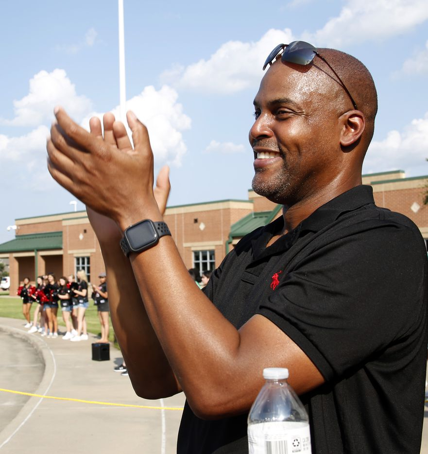Earl Moore applauds as a caravan of cars arrive to show their support for his daughter, Jasmine , as she prepares to depart to compete for the USA team in the Tokyo Olympics. The Olympic Send-Off for the Mansfield Lake Ridge graduate was held at Vernon Newsom Stadium in Mansfield on July 21, 2021. (Steve Hamm/ Special Contributor)