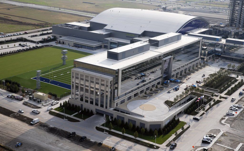 Dallas Cowboys headquarters portion of The Star seen in the foreground as well as the multi-use event center and practice fields in Frisco on Wednesday, July 27, 2016. The Star, a joint project with the City of Frisco is scheduled to open in August. (Vernon Bryant/The Dallas Morning News)
