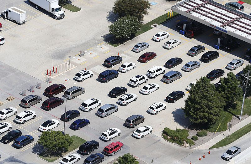 Lines of cars waiting to pump gas stretch into the parking lot Thursday at the Costco store at Sam Rayburn Tollway and Interstate 35 in Lewisville.