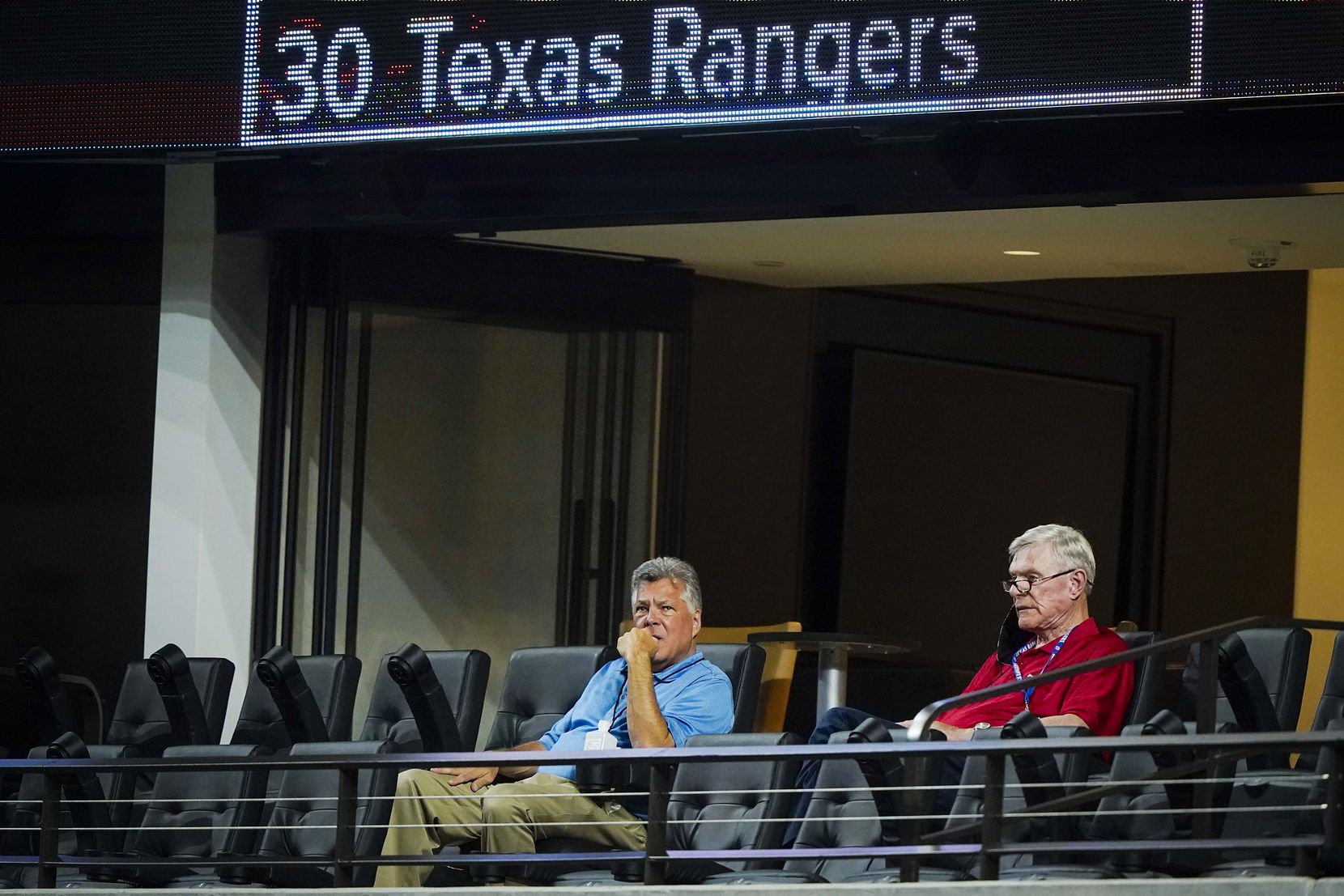 Texas Rangers co-chairman and managing partner Ray C. Davis (right) and chairman, ownership committee and chief operating officer Neil Leibman watch from the stands during the sixth inning of an exhibition game against the Colorado Rockies at Globe Life Field on Tuesday, July 21, 2020.