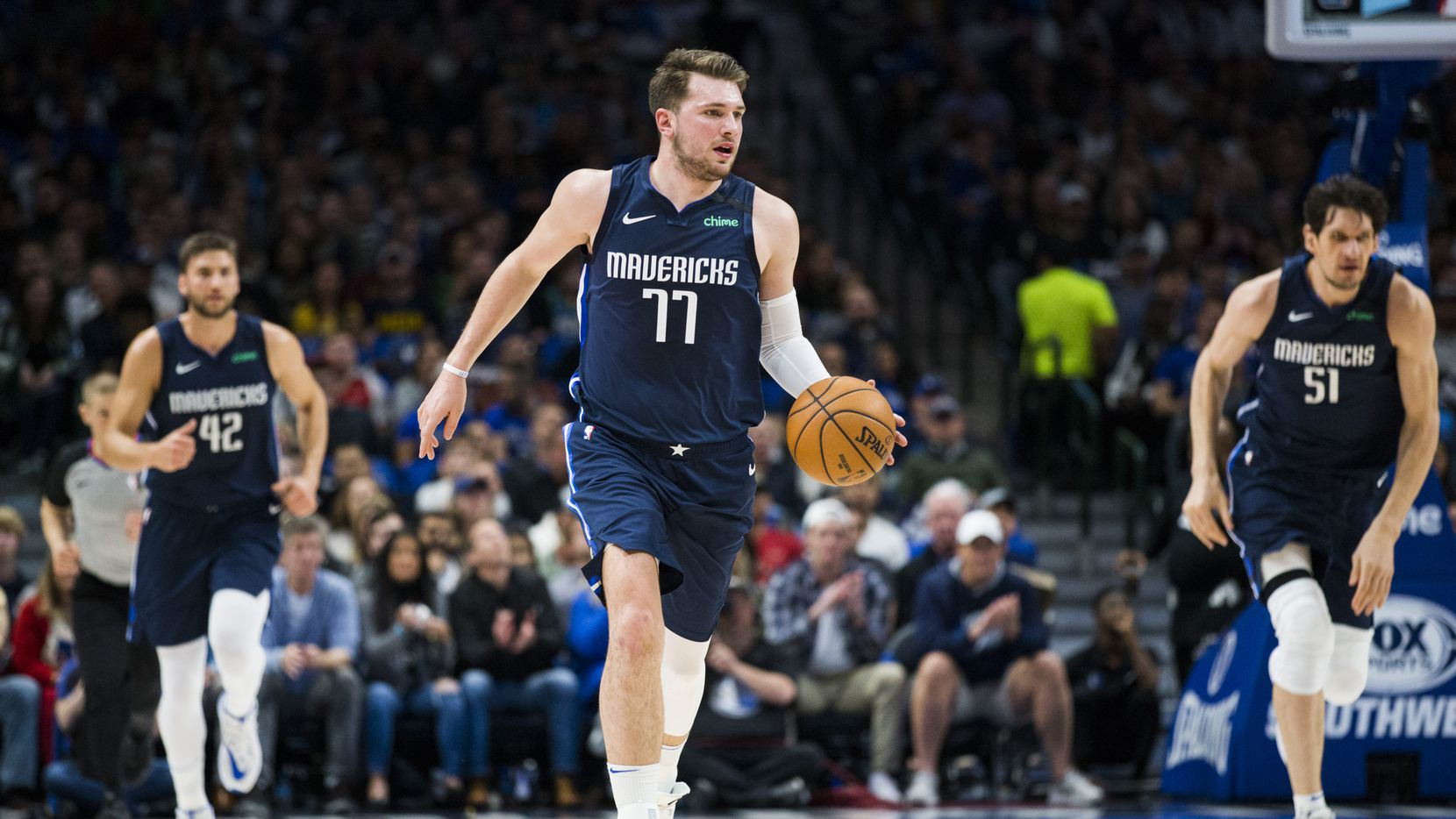 Dallas Mavericks guard Luka Doncic (77) takes the ball down the court during the second quarter of an NBA game between the Indiana Pacers and the Dallas Mavericks on Sunday, March 8, 2020 at American Airlines Center in Dallas.