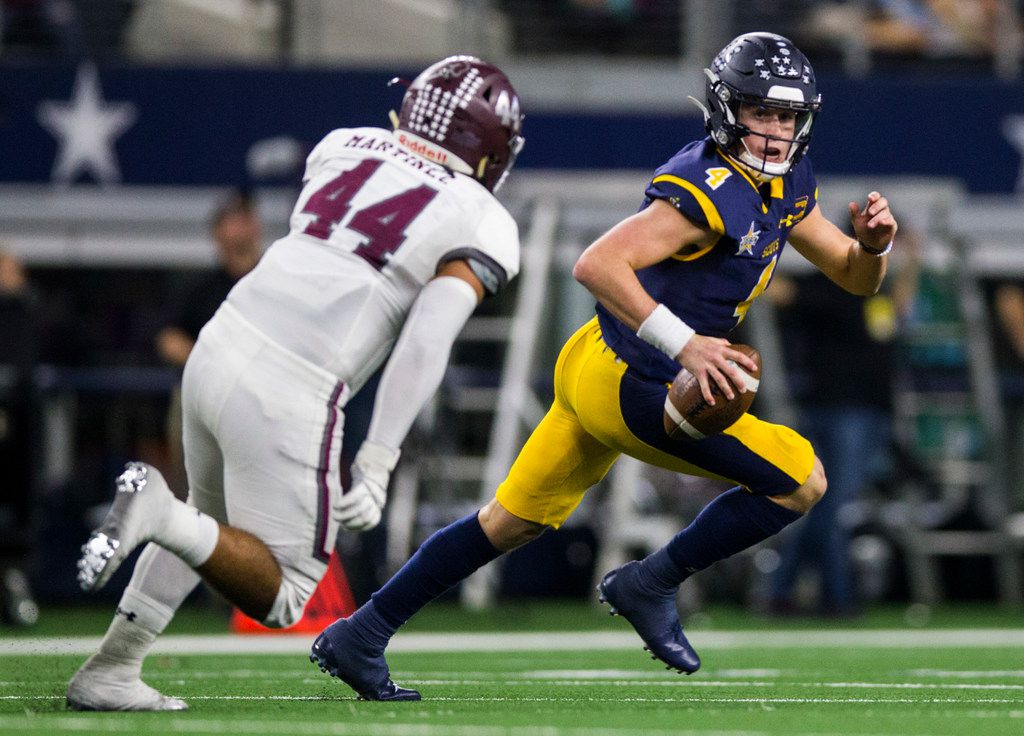 Highland Park quarterback Chandler Morris (4) is threatened by Magnolia defensive lineman Anthony Martinez (44) during the second quarter of a Class 5A Division I area-round playoff game between Magnolia and Highland Park on Thursday, November 21, 2019 at AT&T Stadium in Arlington. (Ashley Landis/The Dallas Morning News)