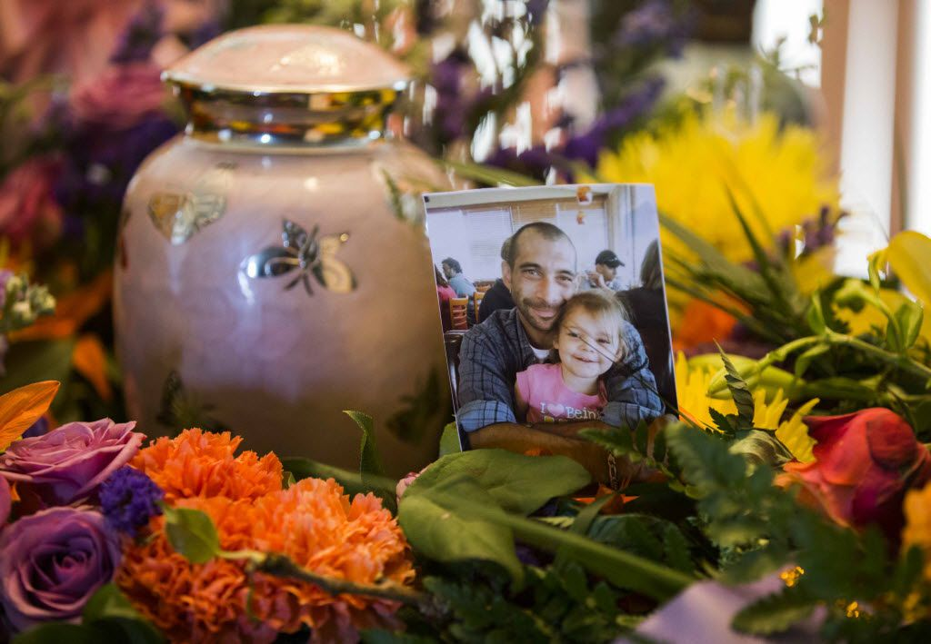 A pink urn containing the remains of four-year-old Leiliana Rose Wright sat with a photo of her father, Brian Maker of Richland Hills.