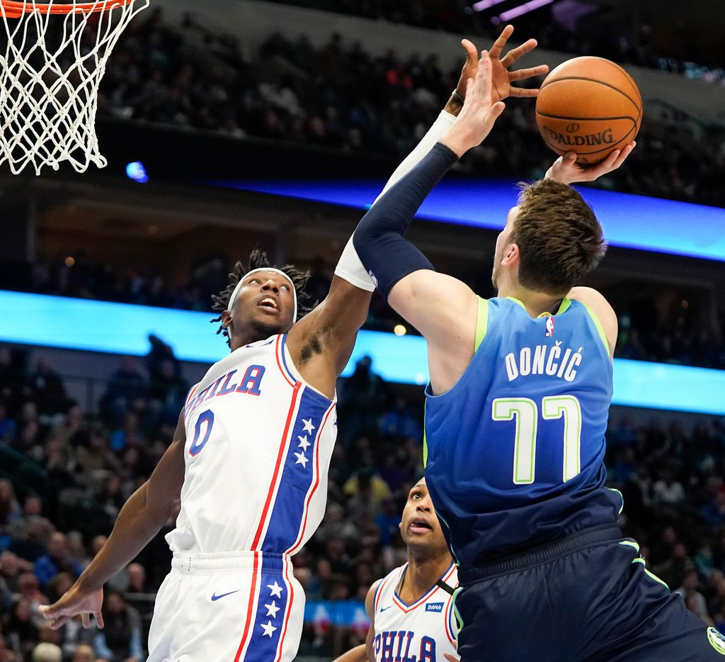 FILE - Mavericks guard Luka Doncic (77) shoots over 76ers wing Josh Richardson (0) during the second half of a game at American Airlines Center on Saturday, Jan. 11, 2020, in Dallas.