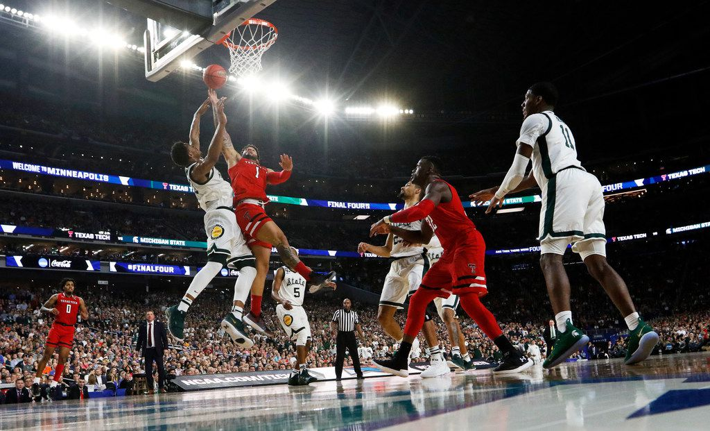 Texas Tech Red Raiders guard Brandone Francis (1) attempts a layup in front of Michigan State Spartans forward Xavier Tillman (23) during the second half of play in the semifinals of the Final Four NCAA college basketball tournament at U.S. Bank Stadium in Minneapolis on Saturday, April 6, 2019. Texas Tech Red Raiders defeated the Michigan State Spartans 61-51. (Vernon Bryant/The Dallas Morning News)
