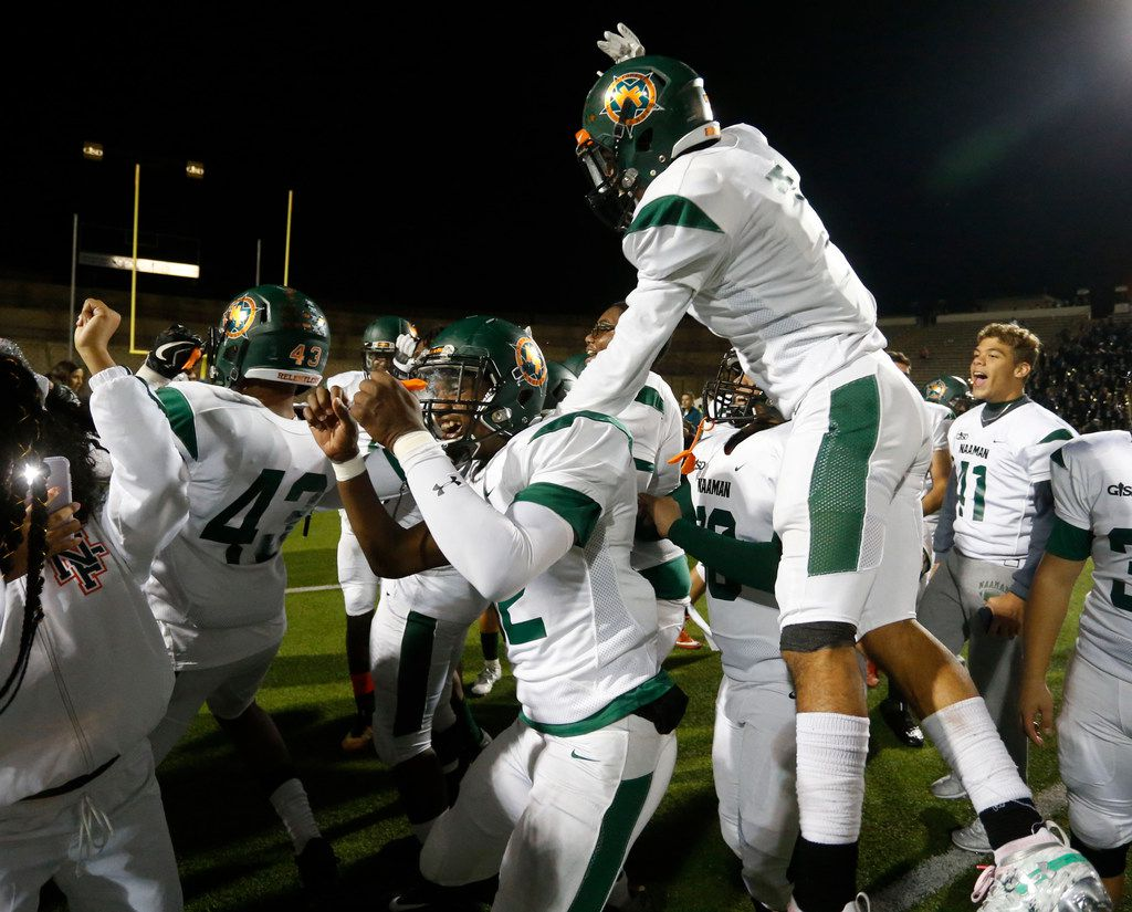 Naaman Forest players, including Shaft Davis (32), celebrate their 42-27 win over Lakeview Centennial in a high school football game at Homer B. Johnson Stadium on Friday, November 8, 2019. (John F. Rhodes / Special Contributor)
