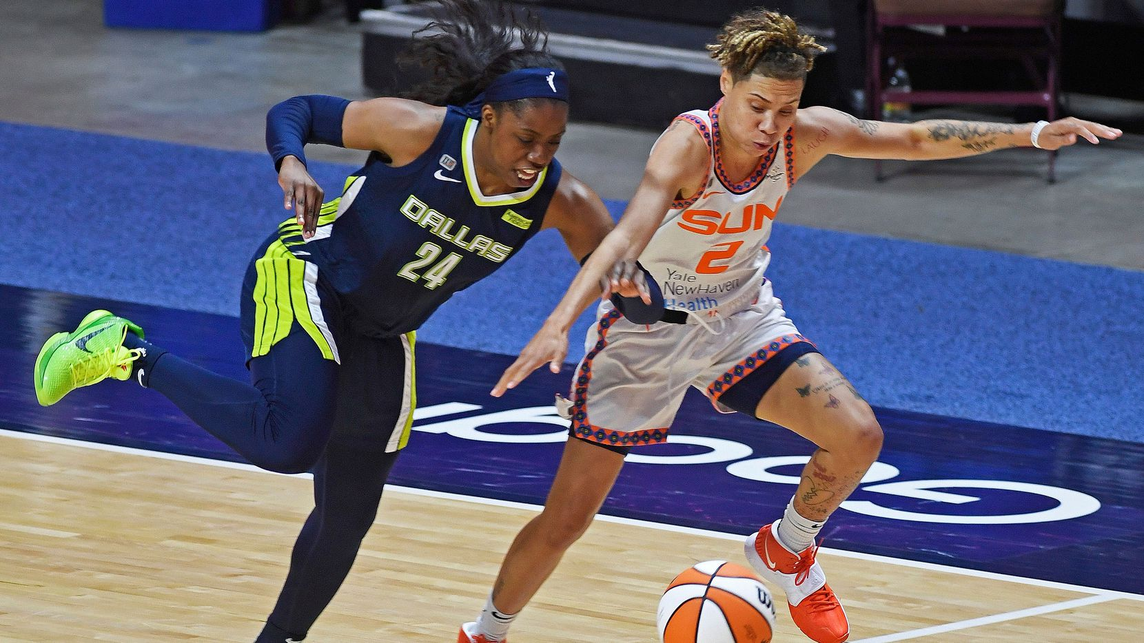 Dallas Wings guard Arike Ogunbowale deflects the ball away from Connecticut Sun guard Natisha Hiedeman during a WNBA basketball game Tuesday, June 22, 2021 at Mohegan Sun Arena in Uncasville, Conn.