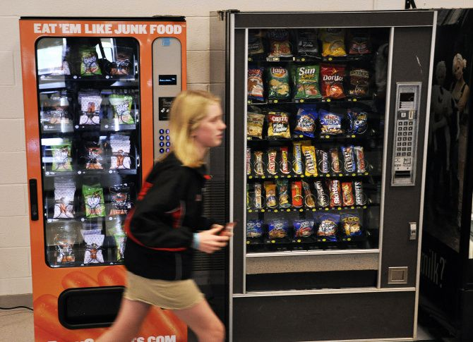 A student passes vending machines - including one filled with healthy options - during lunch period at Fayetteville-Manlius High School in Manlius, N.Y.