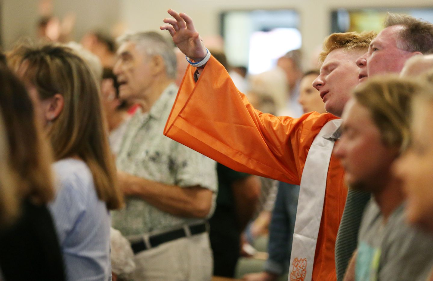 After being recognized with other graduating high school seniors, a student worships during service at Arcadia First Baptist Church in Santa Fe
