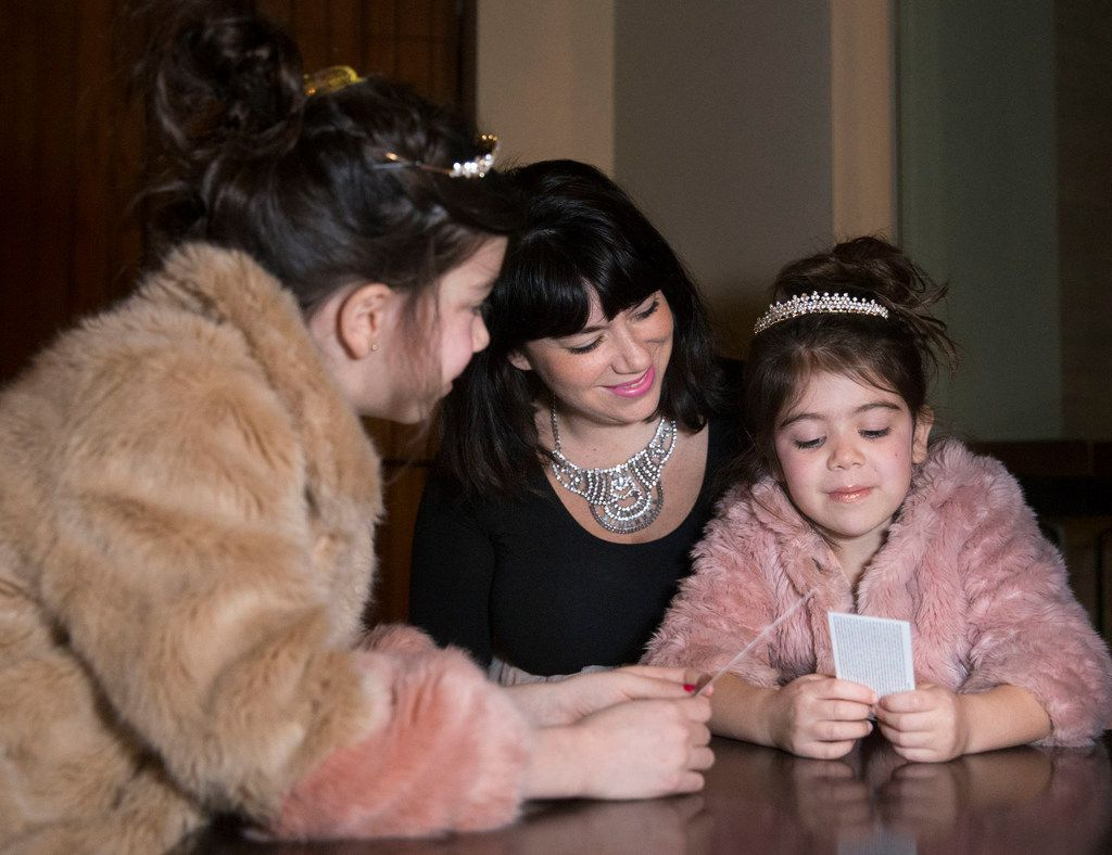 From left, 8-year-old Dotty Rico and her mother, Alicia Rico, talk with Dotty's sister, 5-year-old Pia Rico before a performance of Anastasia at the Music Hall at Fair Park in Dallas on Feb. 19, 2019. The Rico sisters were dressed as Anastasia, the lead character from the play. They both wore tiaras they got when they saw the musical in New York City last year.