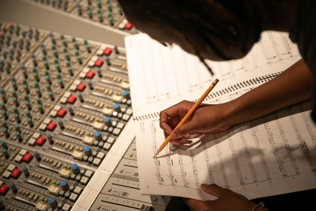 Damoyee Janai Neroes working on the composition that will provide the new music that accompanies the ascent of the chandelier at the Winspear Opera House.