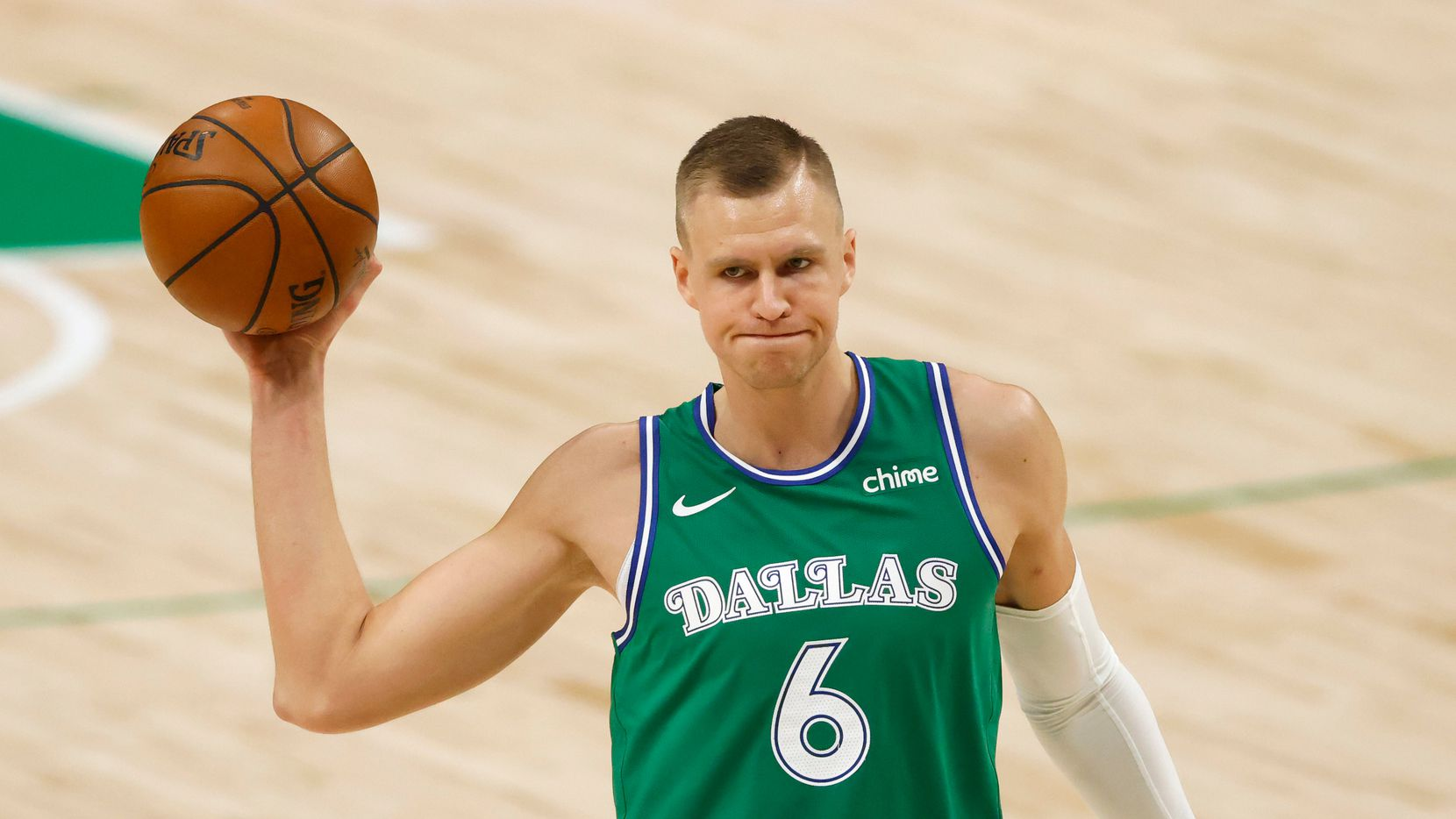 Dallas Mavericks forward Kristaps Porzingis (6) looks to pass as Minnesota Timberwolves center Naz Reid (11) defends during the first quarter of play at American Airlines Center on Monday, February 8, 2021 in Dallas.
