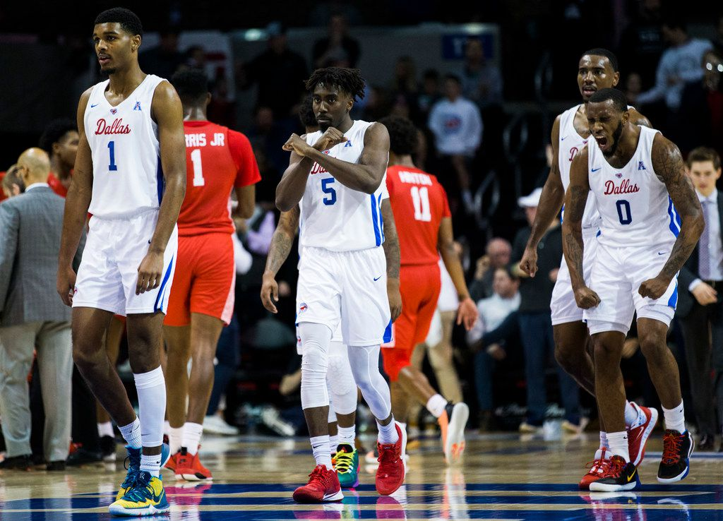 Southern Methodist Mustangs celebrates a point during the second half of a basketball game between SMU and University of Houston on Saturday, February 15, 2020 at Moody Coliseum in Dallas. (Ashley Landis/The Dallas Morning News)