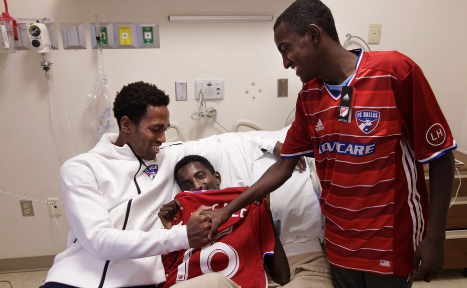 FC Dallas player Atiba Harris, left, visits with 16-yr-old Tamirat Bogale and 16-yr-old Marcos Bogale at Medical Center Plano in Plano, TX, on Dec. 16, 2016. (Jason Janik/Special Contributor)