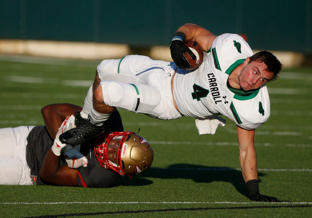 Southlake Carroll running back TJ McDaniel (4) gets tackled by South Grand Prairie linebacker Milton Phifer (38) during the first half of their high school football game in Grand Prairie, Thursday Aug 30, 2018. (Michael Ainsworth/Special Contributor)
