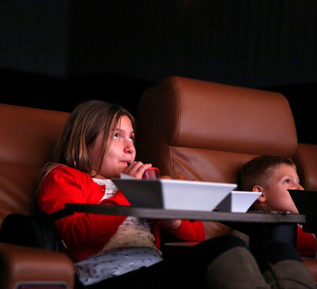 Grace Bucknell, 9 and Wyatt Bucknell, 8, of Frisco watch the movie screen.