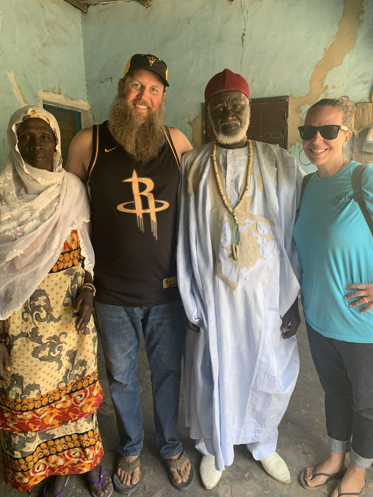 Jason Michael Walker and Amber Grayson, Peace Corps Volunteers, with their host parents in Senegal, father Therno and mother Aisatou, saying their goodbyes in the village of Kayere Hal, after Peace Corps suspended operations worldwide due to the COVID-19 pandemic in March 2020.