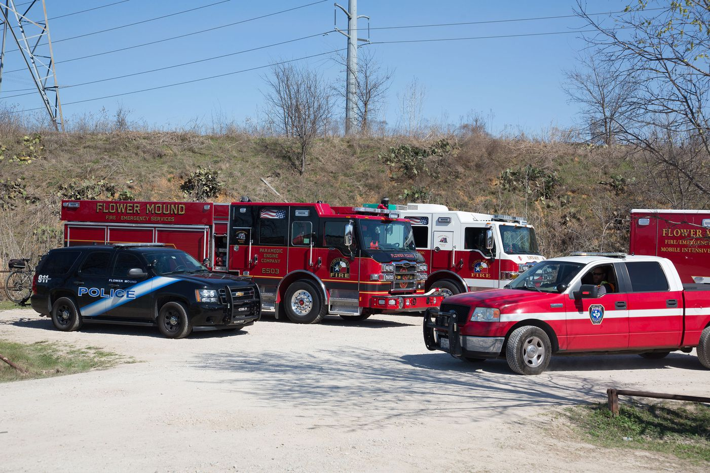 The Flower Mound Fire and Police Department investigate and search for a 2-year-old's missing father at Knob Hills Bike Trail, Tuesday, March 7, 2017, in Roanoke, Texas.