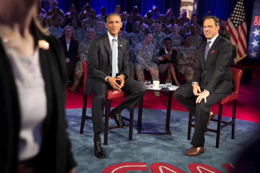 President Barack Obama and CNN's Jake Tapper at a town hall with military personnel and their families at Fort Lee in Virginia.