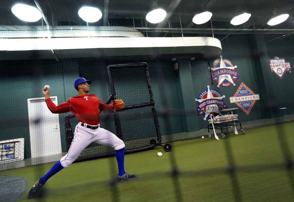 Pitcher Dillon Tate throws in their indoor workout area  of Globe Life Park in Arlington during the Texas Rangers winter minicamp in Arlington, Texas, Thursday, January 21, 2016. (Tom Fox/The Dallas Morning News)