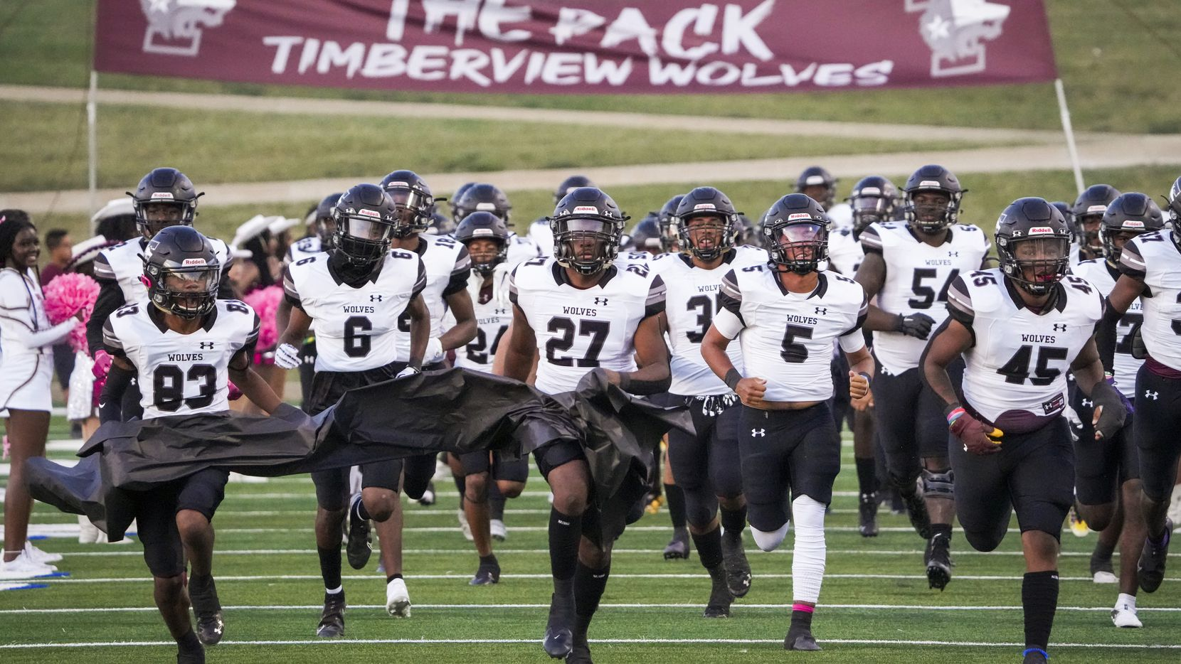 Mansfield Timberview take the field before facing Waco University in a high school football game at Waco ISD Stadium on Friday, Oct. 8, 2021, in Waco, Texas. A shooting following a classroom fight on Wednesday injured four people at Timberview High School.(Smiley N. Pool/The Dallas Morning News)