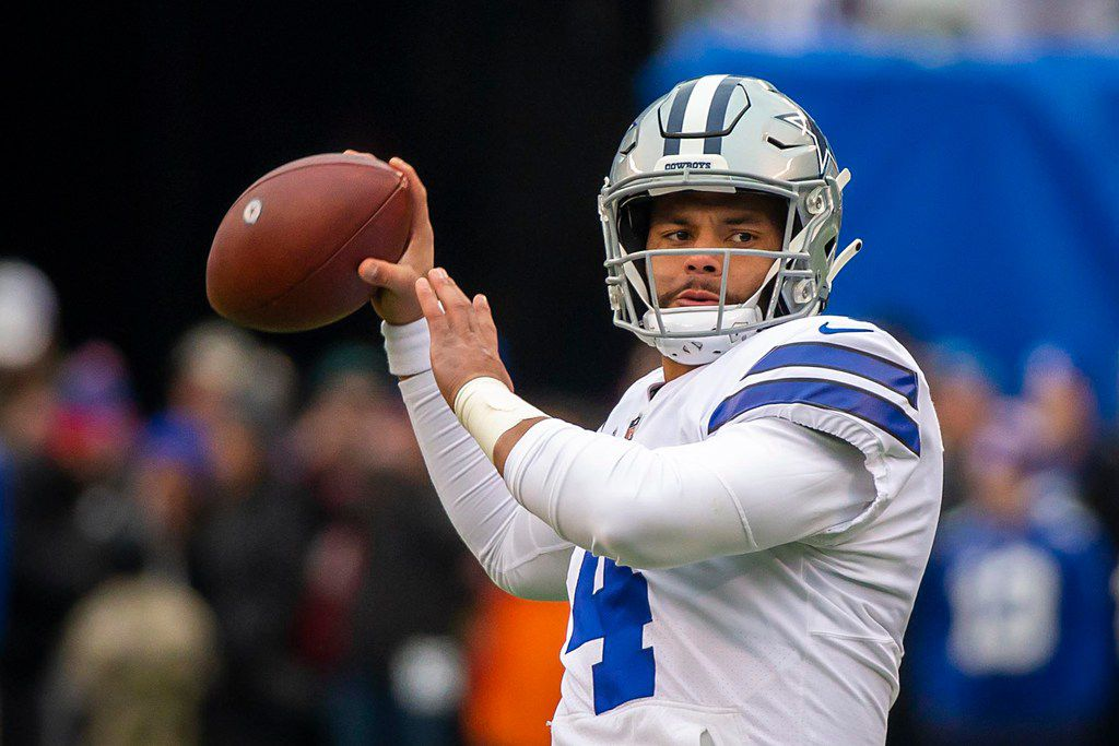 FILE - Cowboys quarterback Dak Prescott warms up before a game against the New York Giants at MetLife Stadium on Sunday, Dec. 30, 2018, in East Rutherford, N.J. (Smiley N. Pool/The Dallas Morning News)