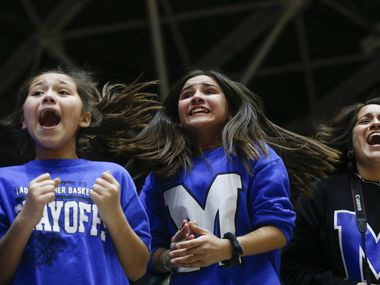 Kyla Crawford, 10, left, and Mackenzie Barnes, 11, and Estela Crawford celebrate Midlothian's Class 5A Region II girls basketball semifinal win over Frisco Lone Star on Friday, Feb. 28, 2020 at Curtis Culwell Center in Garland, Texas.