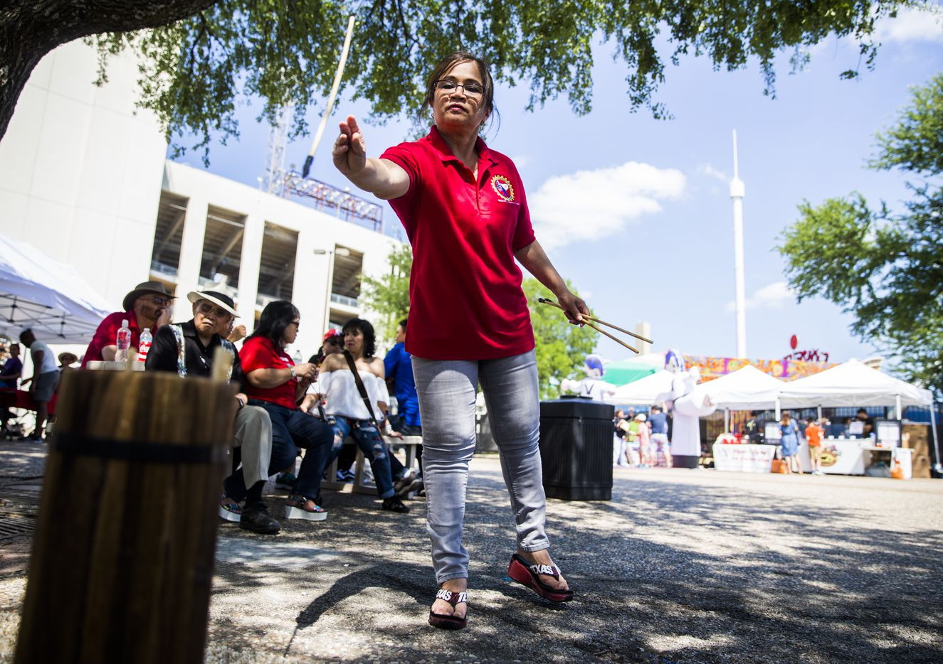 Elna Mallari plays a traditional Korean game during the 27th Home Depot Asian Festival on Saturday, May 13, 2017 at Cotton Bowl Plaza in Dallas Fair Park.