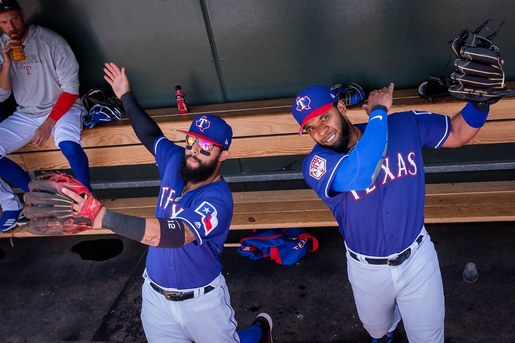 Texas Rangers second baseman Rougned Odor (left) and shortstop Elvis Andrus perform their pregame ritual, mimicking a swing for the fences, before a spring training baseball game against the Chicago White Sox on Friday, March 1, 2019, in Surprise, Ariz.. (Smiley N. Pool/The Dallas Morning News)