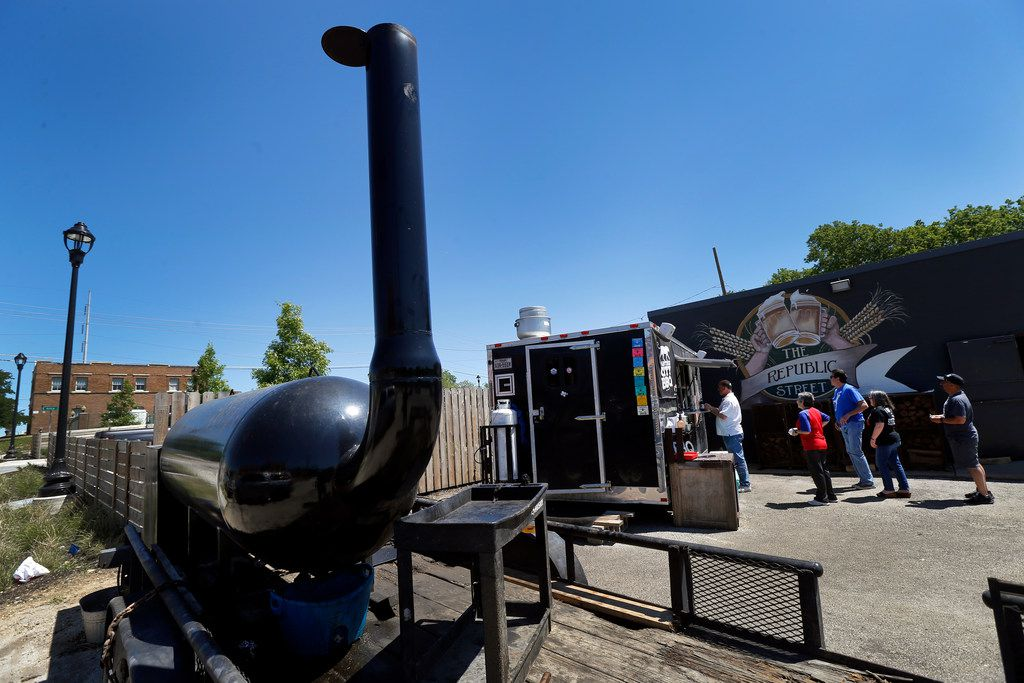 Panther City BBQ co-pitmasters Ernie Morales and Chris Magallanes smoke their meats on a trailer mounted Moberg smoker which is parked next to The Republic Street Bar in Fort Worth, Saturday, April 19, 2019. They have a permanent location being built on a vacant lot on the opposite side of the bar. (Tom Fox/The Dallas Morning News)