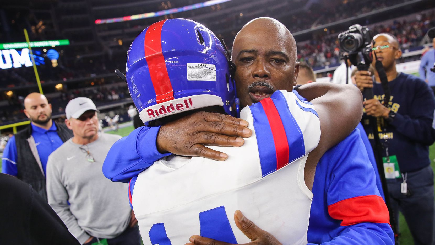 Duncanville's coach Reginald Samples consoles quarterback Chris Parson (14) after losing a Class 6A Division I state championship game against North Shore at the AT&T Stadium in Arlington, on Saturday, December 21, 2019. North Shore won 31-17. (Juan Figueroa/The Dallas Morning News)