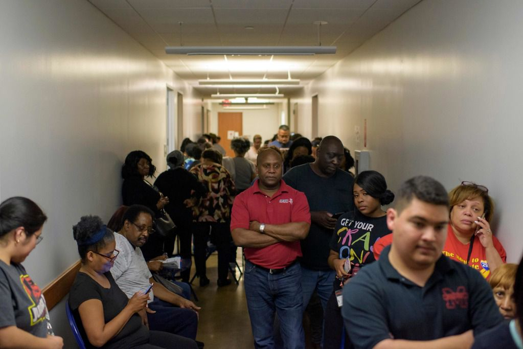 Voters line up at a polling station to cast their ballots during the presidential primary in Houston on Super Tuesday, March 3, 2020.
