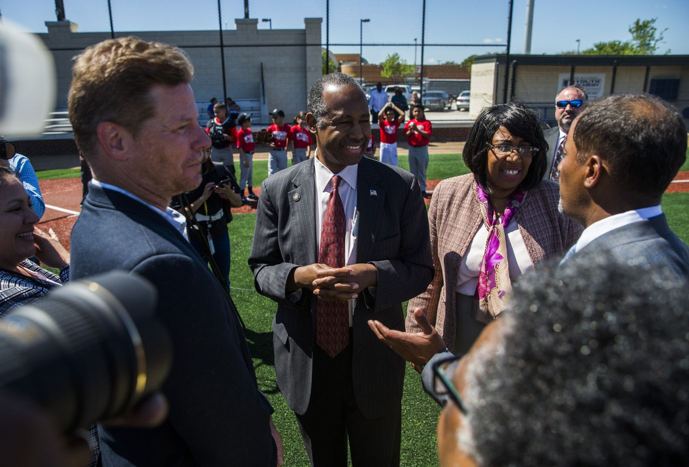 U.S. Secretary of Housing and Urban Development Ben Carson, center, and his wife, Candy Carson, speak to supporters while they take a tour of the Dallas Housing Authority. (Ashley Landis/The Dallas Morning News)