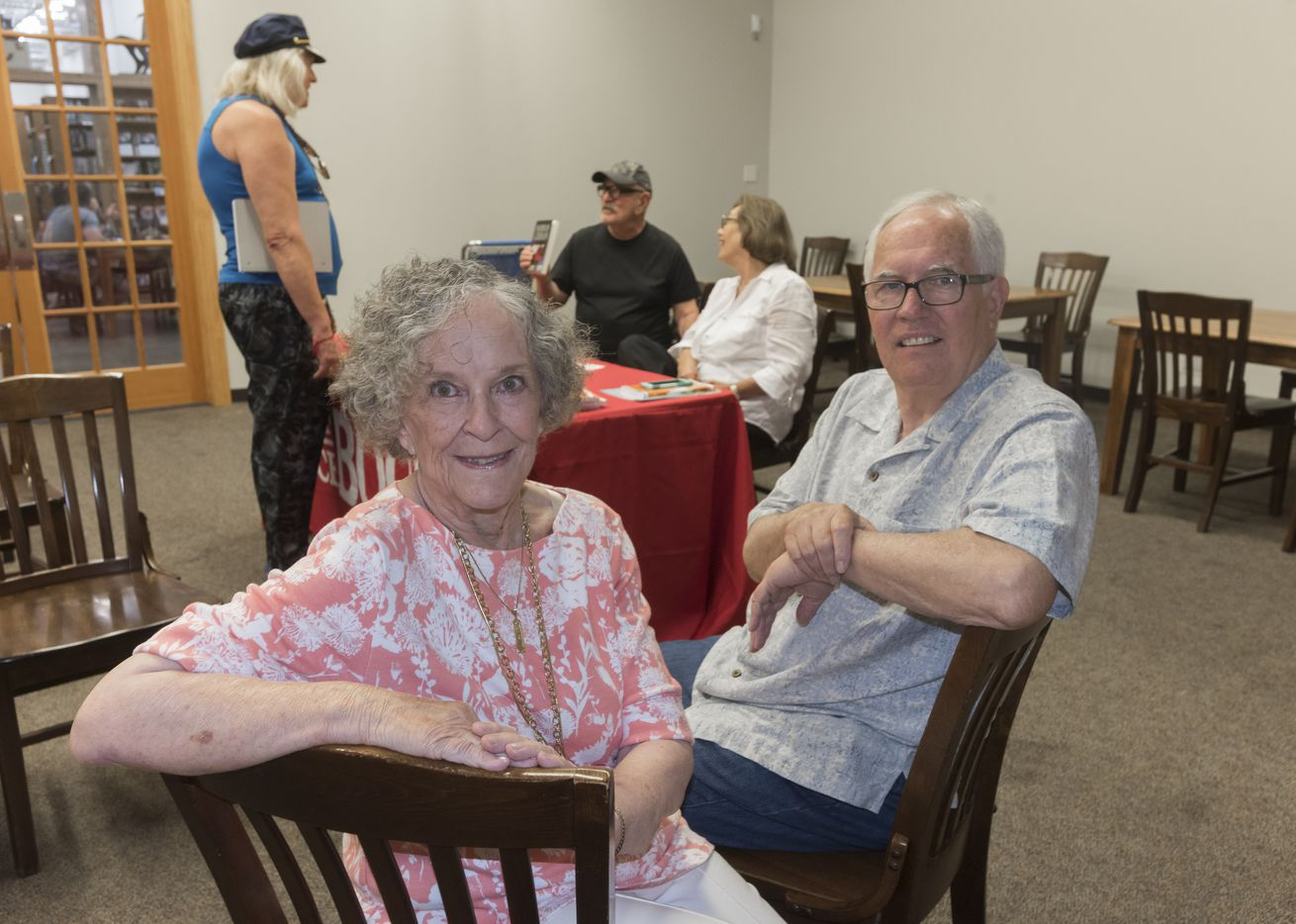 Ginnie Siena Bivona, left, and Larry Upshaw have have launched Ageless Authors, a publishing project for people 65 and older.  They are at a book signing event at Half Price Books on June, 26, 2016.   (Rex C. Curry/Special Contributor)