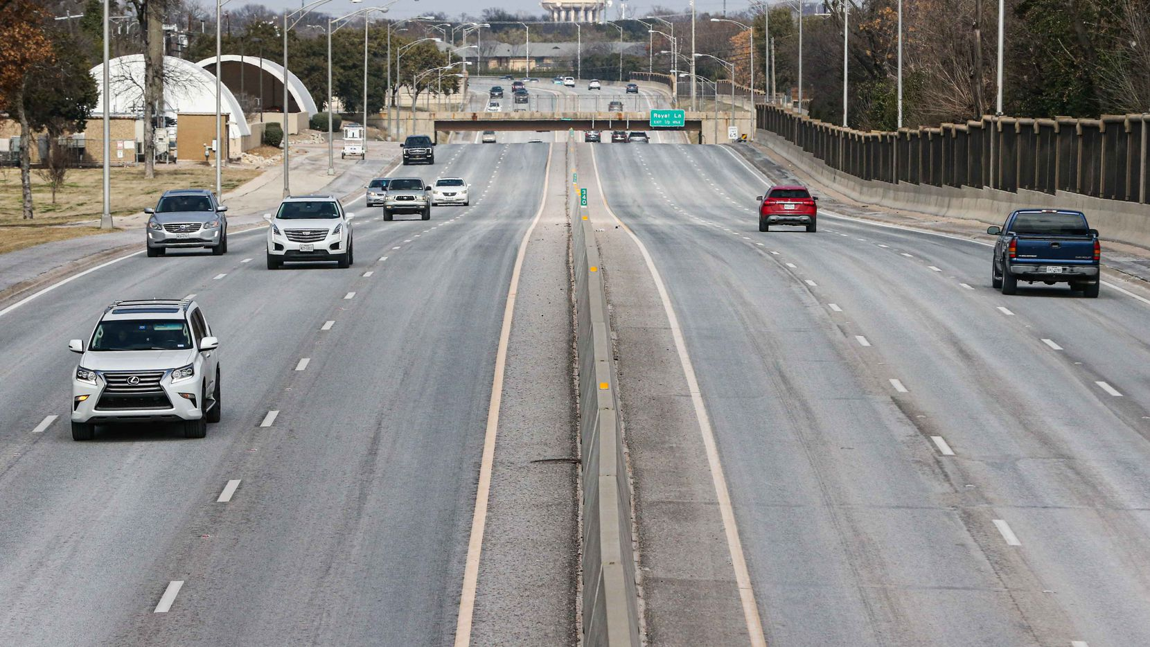 Traffic on Dallas North Tollway under Walnut Hill Lane in Dallas on Saturday, February 13, 2021. (Lola Gomez / The Dallas Morning News)