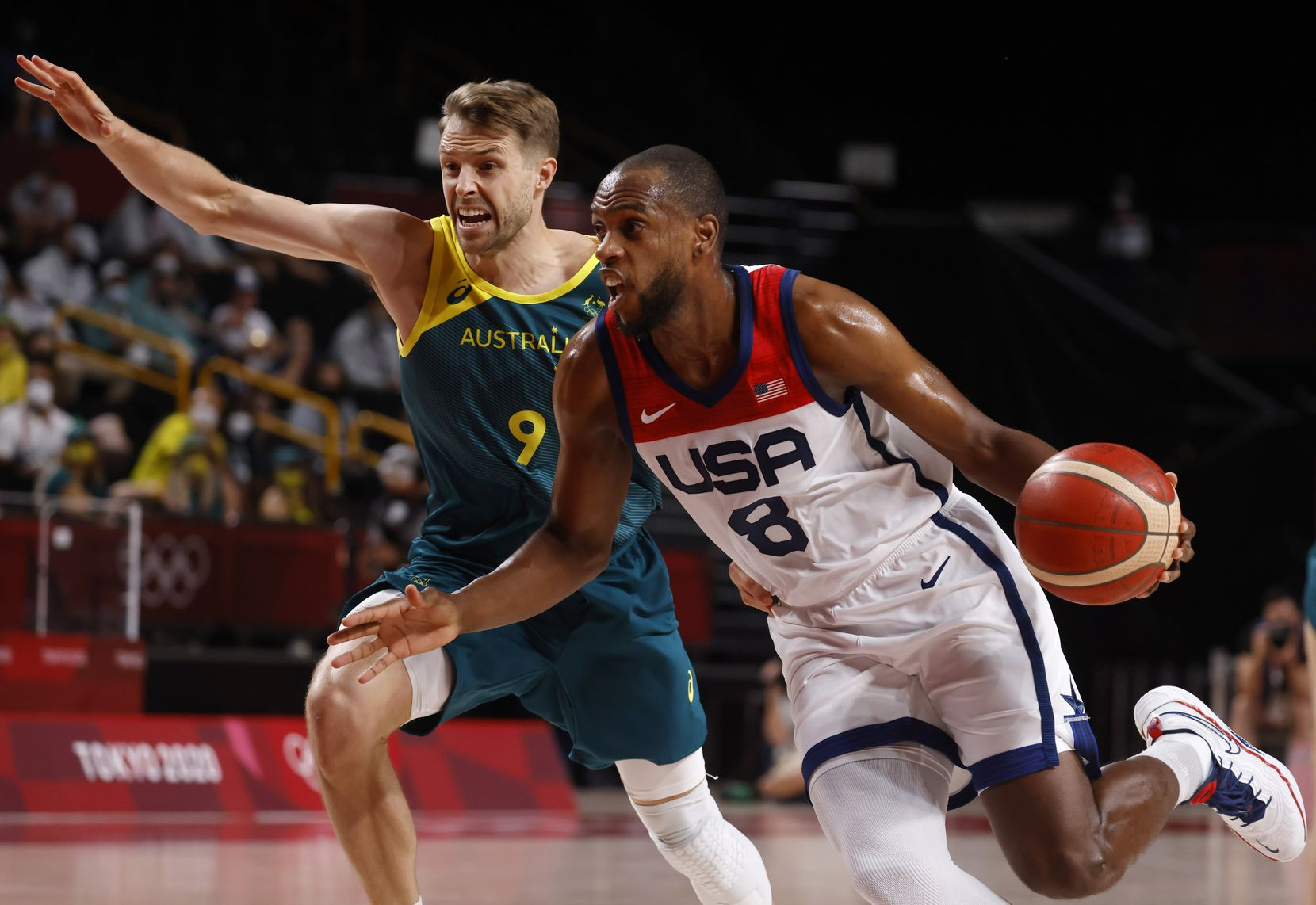 USA's Khris Middleton (8) drives on Australia's Nathan Tobey (9) during the first half of a men's basketball semifinal at the postponed 2020 Tokyo Olympics at Saitama Super Arena, on Thursday, August 5, 2021, in Saitama, Japan. USA defeated Australia 97-78 to advance to the gold medal game. (Vernon Bryant/The Dallas Morning News)