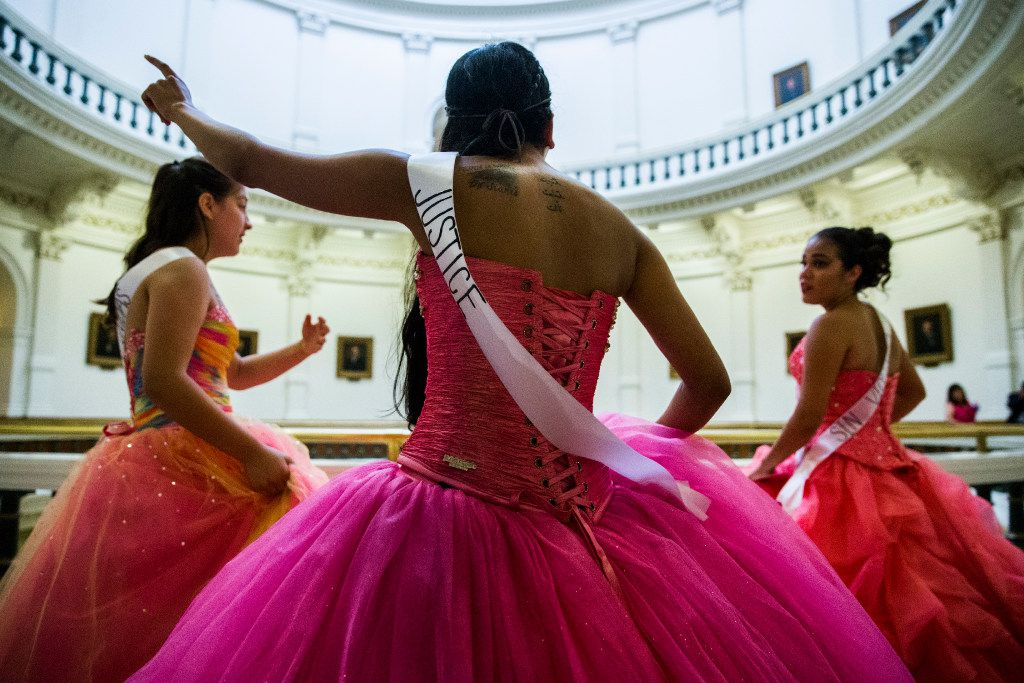 Leslie Abraham (center), Julia Pierce (left) and Alesandra Lopez look for a senator's office after they and other teenage girls held symbolic quinceaneras to protest the sanctuary cities ban on Wednesday at the Texas Capitol in Austin.