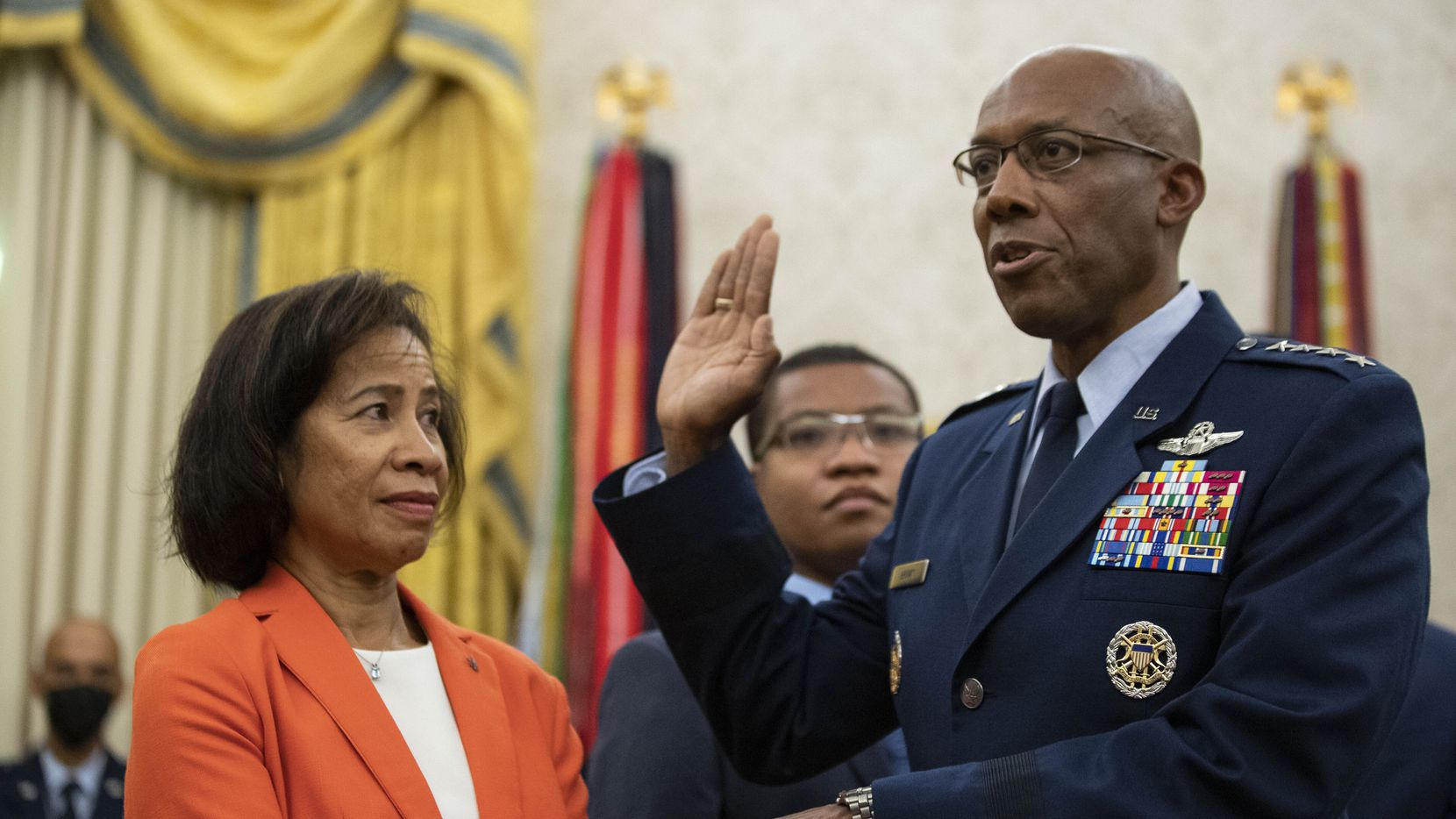 Gen. Charles Q. Brown Jr., is sworn is as Chief of Staff of the Air Force as his wife Sharene Guilford Brown holds a Bible, in the Oval Office of the White House, Aug. 4, 2020, in Washington. (AP Photo/Alex Brandon)