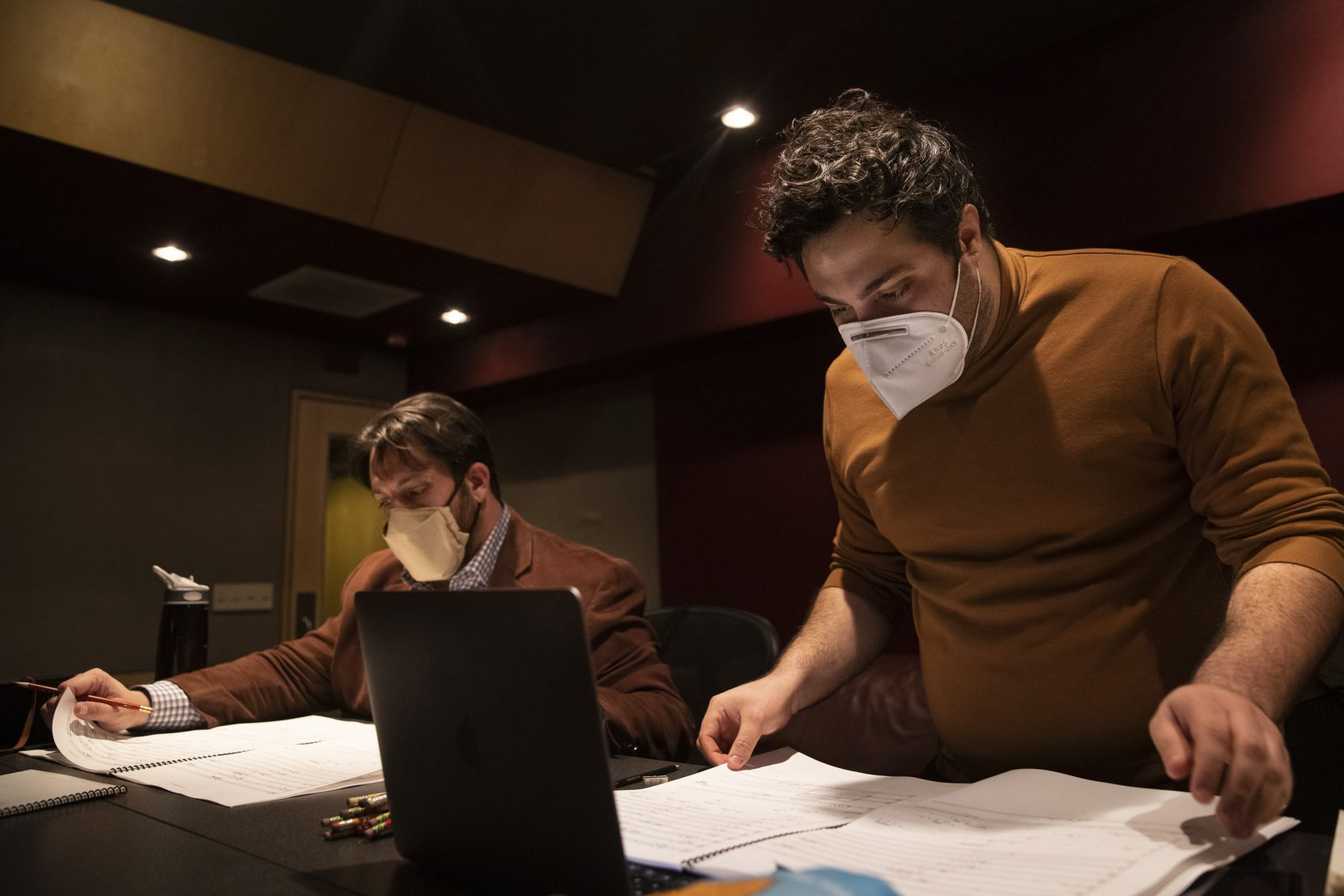 Producer Anthony Maglione (left) and artistic director Sam Brukhman review scores as members of the Verdigris Ensemble record 'Betty's Notebook' by Texas-born composer Nicholas Reeves at Luminous Sound on Jan. 23, 2021, in Dallas. The ensemble will be selling and releasing the project on blockchain.