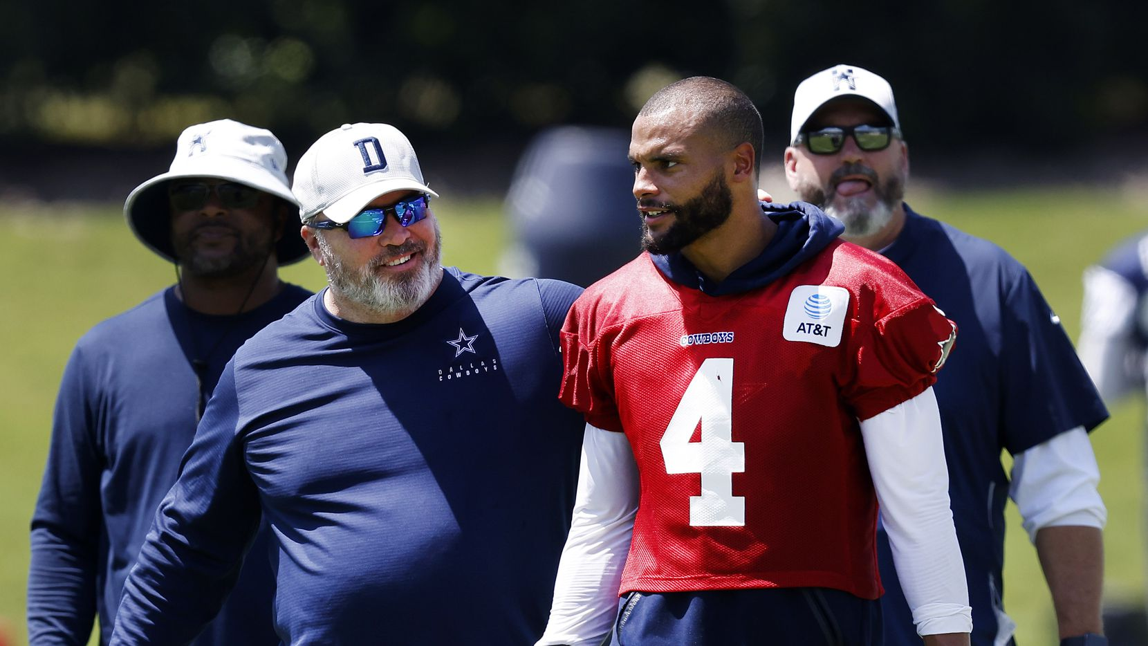 Dallas Cowboys head coach Mike McCarthy pats quarterback Dak Prescott (4) on the back following Training Camp practice at The Star in Frisco, Texas, Wednesday, August 25, 2021.